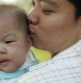 Father  kissing baby. - Alex Microstock02