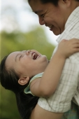 Father carrying young daughter, looking down - Alex Microstock02