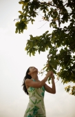 Young woman touching a tree branch - Alex Microstock02