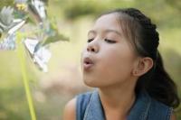 Young girl blowing a pinwheel - Alex Microstock02