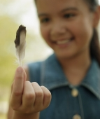 Young girl holding a feather - Alex Microstock02