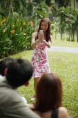 Young woman taking a picture of her friends - Alex Microstock02