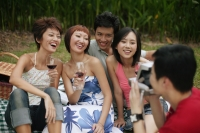 Friends posing for pictures, holding wine glasses - Alex Microstock02