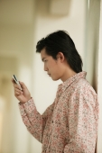 Young man using mobile phone - Alex Microstock02