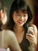 Young woman using mobile phone. - Alex Microstock02