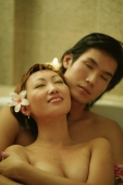 Couple embracing in tub, eyes closed - Alex Microstock02