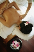 Young woman at a spa, being massaged - Alex Microstock02