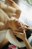 Young man receiving head massage, eyes closed - Alex Microstock02