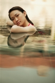 Young woman, at edge of swimming pool, looking at camera - Alex Microstock02