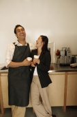 Couple in kitchen, laughing - Eckersley/Peacock