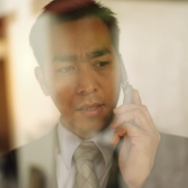 Businessman on mobile phone - Eckersley/Peacock