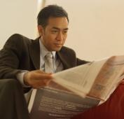 Businessman reading newspaper - Eckersley/Peacock
