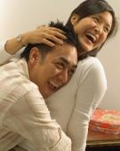 Man hugging woman, laughing - Eckersley/Peacock