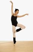 Young woman balancing on toes. - Erik Soh