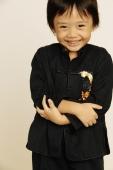 Young boy smiling, looking at camera - Erik Soh