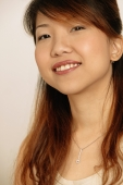 Portrait of a young woman, smiling - Erik Soh