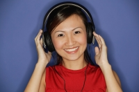 Young woman wearing headphones,  smiling - Alex Microstock02