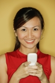 Young woman wearing a red top, holding a mobile phone - Alex Microstock02