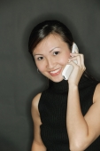 Young woman wearing a black top, using a mobile phone - Alex Microstock02