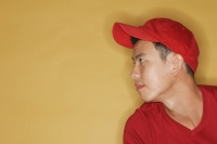 Young man wearing a red cap, against a yellow background - Alex Microstock02