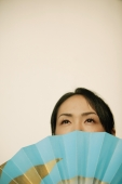 Young woman, face obscured by fan - Alex Microstock02