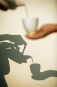 Pouring tea, shadow in the background - Alex Microstock02