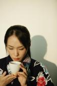 Young woman in kimono holding a tea cup - Alex Microstock02