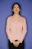 Young woman, standing, hands clasped - Alex Microstock02