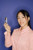 Young woman, using mobile phone, smiling - Alex Microstock02
