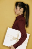 Young woman, side view, yellow background - Alex Microstock02
