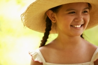 Young girl smiling, wearing hat, looking away - Jack Hollingsworth