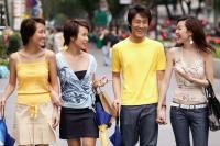 Friends walking side by side, talking, carrying bags - Jack Hollingsworth