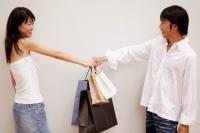 Couple holding shopping bags - Jack Hollingsworth