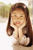 Young girl with hands on chin, looking at camera - Alex Microstock02