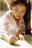 Young girl looking down, writing - Alex Microstock02