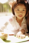 Young girl looking at camera, holding a pen - Alex Microstock02