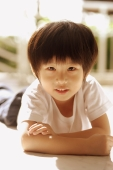 Young boy looking at camera, arms crossed - Alex Microstock02
