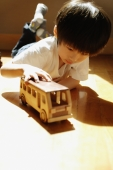 Young boy playing with toy bus - Alex Microstock02