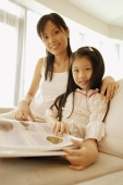 Mother and daughter, sitting side by side, looking at camera, smiling - Alex Microstock02
