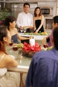 Group of friends having a dinner party at home. - Alex Microstock02