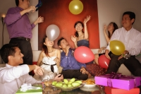 Group of friends having a party at home, playing with balloons - Alex Microstock02