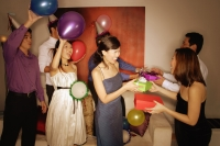 Group of friends exchanging gifts - Alex Microstock02