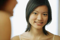 Young woman looking at camera, toothy smile - Alex Microstock02