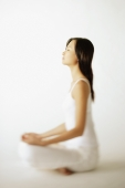 Young woman sitting on floor, profile - Alex Mares-Manton
