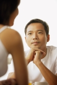 Young man and woman talking, face to face - Alex Microstock02