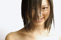 Young woman with wet hair, smiling at camera - Alex Microstock02