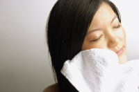 Young woman wiping her face with towel - Alex Microstock02