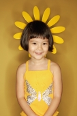 Young girl standing against yellow background - Alex Microstock02