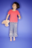 Young girl jumping, holding teddy bear - Alex Microstock02