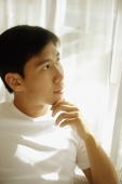 Young man looking away, hand on chin - Alex Microstock02